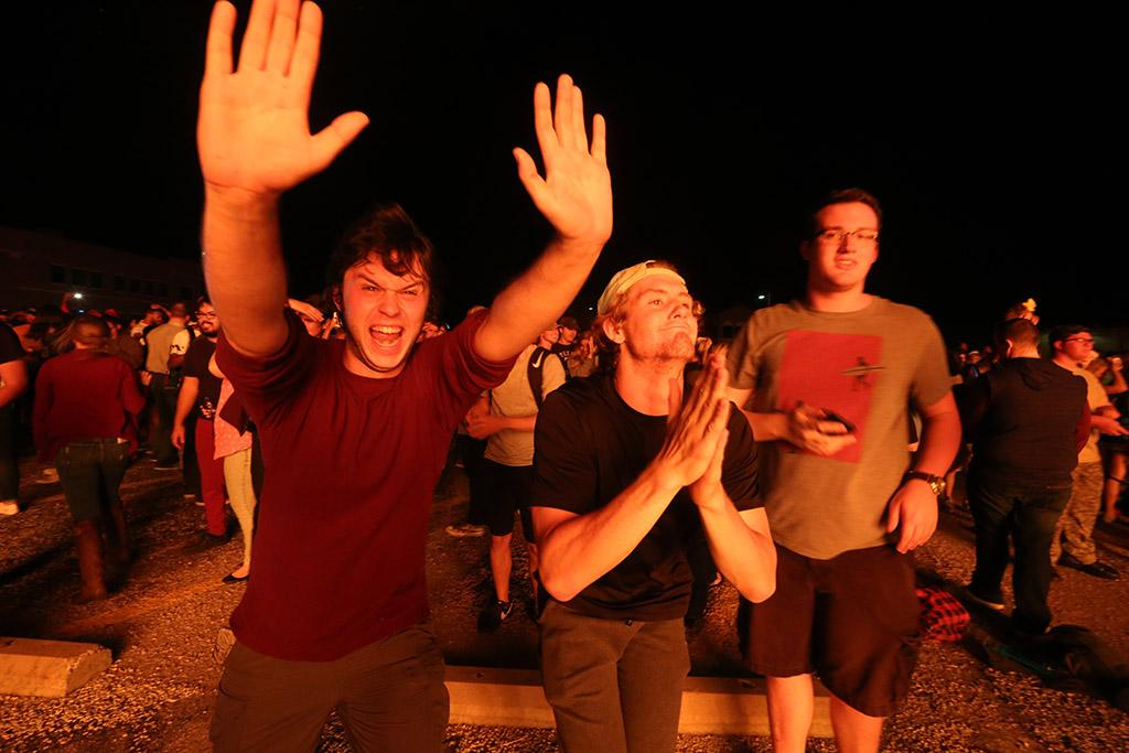 Joey McGinn, Jacob Turnbow and Seth Angelino at the homecoming bonfire Oct. 19, 2017. Photo by Bradley Wilson