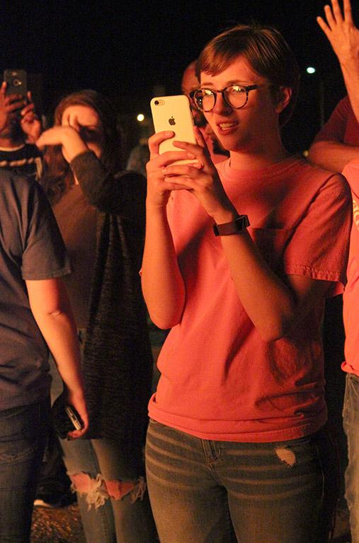 Alexis Rucker, criminal justice sophomore, takes a picture her friends at the Homecoming Bonfire, Thursday, Oct. 19, 2017. Photo by Rachel Johnson