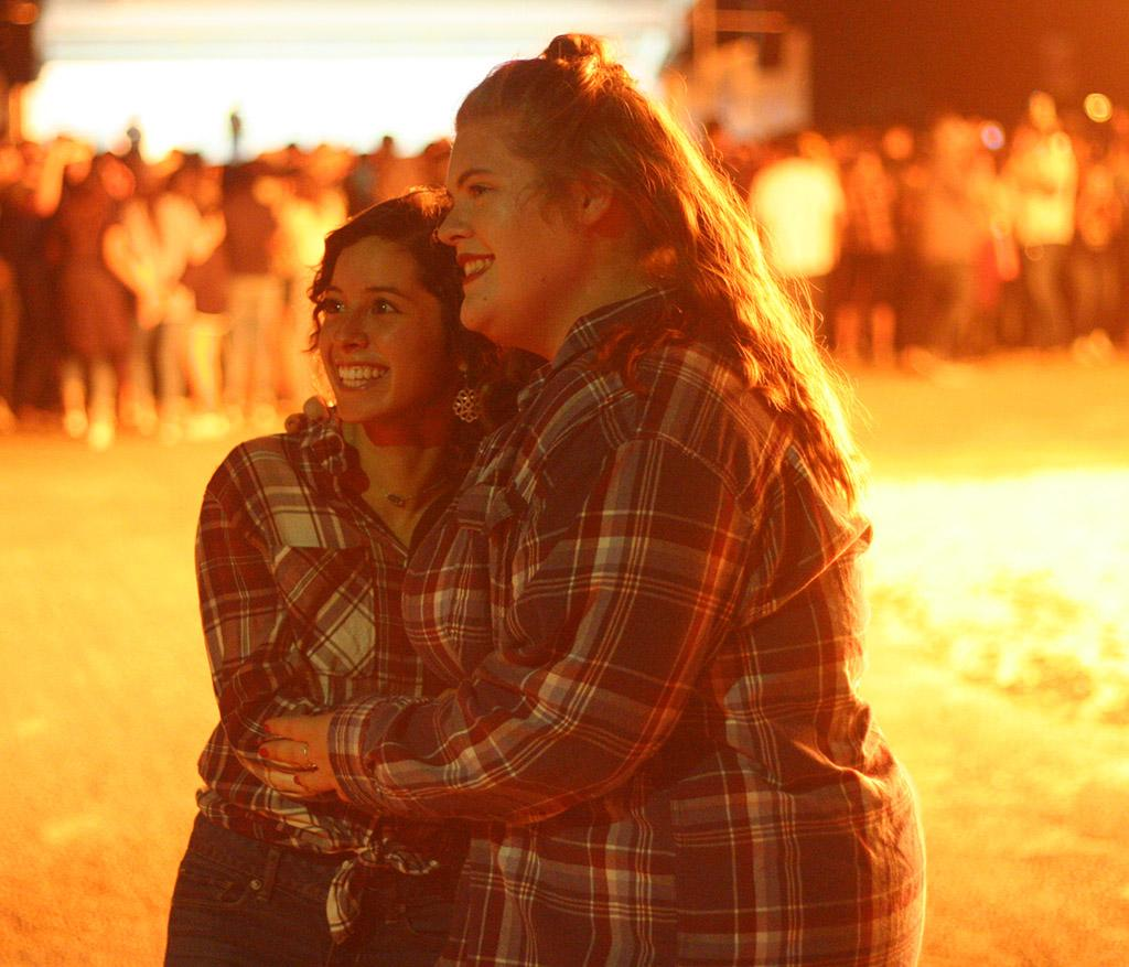 Nicole Buchanan, resident assistant, and Shelby Emerson, education senior, enjoy the bonfire hosted by MSU during homecoming week at the student parking lot on Thursday, Oct. 19, 2017. Photo by Harlie David