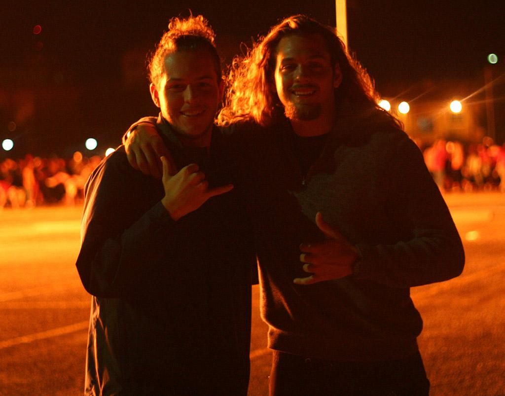 Cameron O'Neal, pre-med sophomore, and Ben Williamson, non-student, enjoy the bonfire at MSU in the student parking lot on Thursday, Oct.19, 2017. Photo by Harlie David