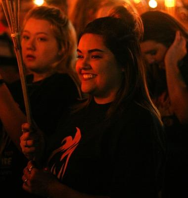 Autumn Duval, early childhood education freshman, enjoys the torchlight parade at MSU on Thursday, Oct. 19, 2017. Photo by Harlie David