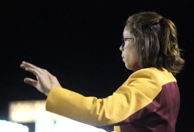 Desire Graves, performance junior, leads the Golden Thunder Marching Band as one of the drum majors during the halftime. Photo by Rachel Johnson