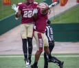 Cullen Craft, sports and leisure senior, and Steven Rogers, business junior, celebrate at the football game against Oklahoma Panhandle State. MSU won 42-24 on Sunday after the game was postponed due to rain the day before. photo by Izziel Latour