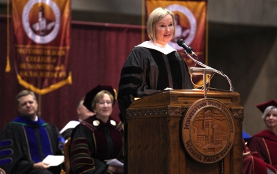 Catherine Davis, MSU Alumna, gives advise to the graduates in the Commencement Ceremony in Kay Yeager Coliseum Dec. 12, 2015. Photo by Francisco Martinez