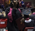A student blows a kiss to the people there for her in the audience at Midwestern State University fall graduation, Dec. 13, 2014 in Wichita Falls, Texas. Photo by Rachel Johnson