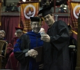 Tyler Hackbarth, computer science, takes a selfie with Jesse Rodgers, university president, at Midwestern State University fall graduation, Dec. 13, 2014 in Wichita Falls, Texas. Photo by Rachel Johnson