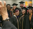Vcmor Eligwe, BFA, Melody Campos, BFA, Nicole Kutzer, BFA, Jake Starkey, BFA, Nick Bourgeois, BFA, Jesse Baggett, BFA, and Samantha Nichols, BA take a group picture while waiting to be moved to the coiseum at Midwestern State University fall graduation, Dec. 13, 2014 in Wichita Falls, Texas. Photo by Rachel Johnson