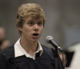 Richie Heussner sings the alma mater at graduation. Photo by Ethan Metcalf