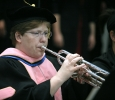 Susan Harvey plays the national anthem at Midwestern State University graduation, May 13, 2017. Photo by Bradley Wilson