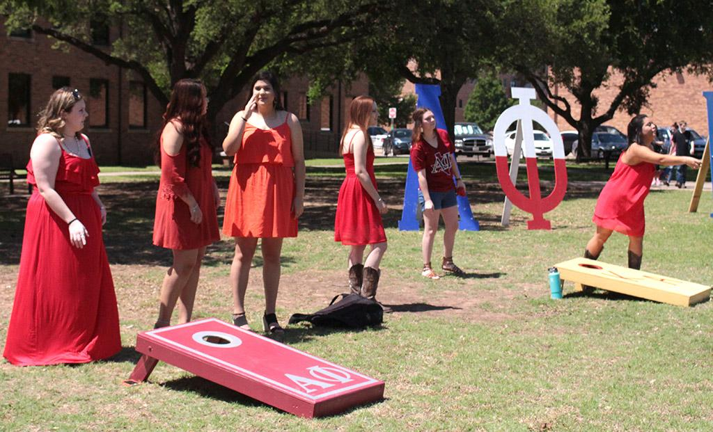 Alpha Phi girls play bean bag toss at Alpha Phi and Kappa Alpha's First Annual Midwestern Cookout Classic in the Quadrangle on April 30. Photos by Kayla White.