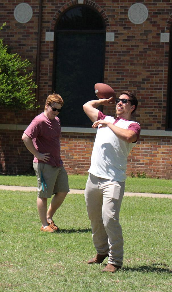 Sam Metzler, buisness freshmen, and Jordan Entler, buisness management freshmen throwing a football across the lawn at Alpha Phi and Kappa Alpha's First Annual Midwestern Cookout Classic in the Quadrangle on April 30. Photos by Kayla White.
