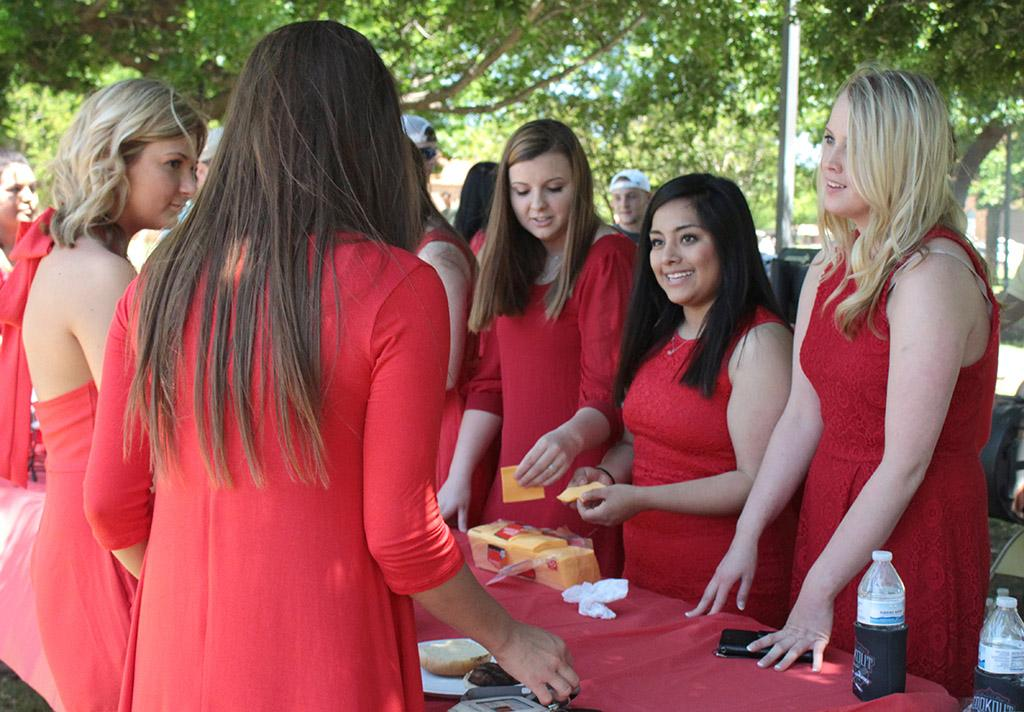 Alpha Phi girls help get the condiments and toppings ready for the Alpha Phi and Kappa Alpha's First Annual Midwestern Cookout Classic in the Quadrangle on April 30. Photos by Kayla White.