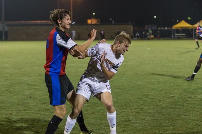 Alex Mullet, finance sophmore, fights for the ball during the heartland conference semi-final game on Nov. 4. Photo by Izziel Latour