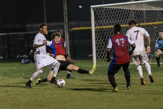 Taylor Leon, finance senior, fights for the ball during the heartland conference semi-final game on Nov 4. Photo by Izziel Latour