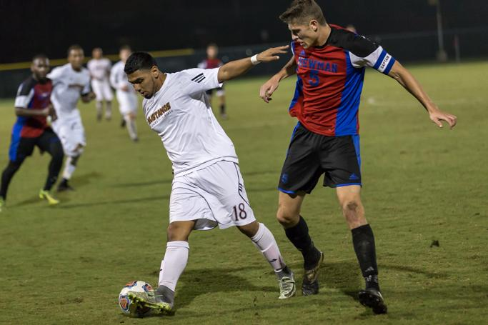 Christopher Mendez, finance junior, fights for the ball during the heartland conference semi-finale game on Nov 4. Photo by Izziel Latour