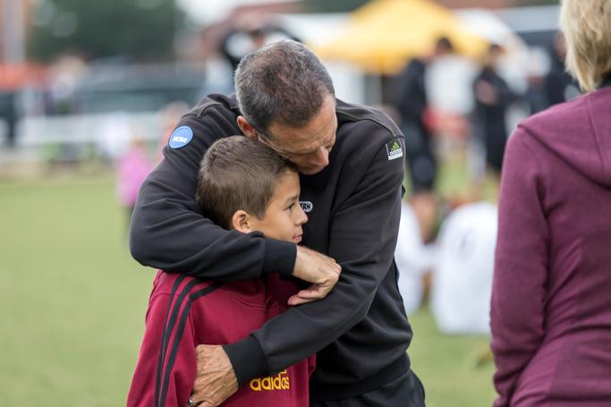 Head soccer coach Doug Elder hugs his son after a 2-0 lose against St. Edward's on Nov. 6.  Photo by Izziel Latour