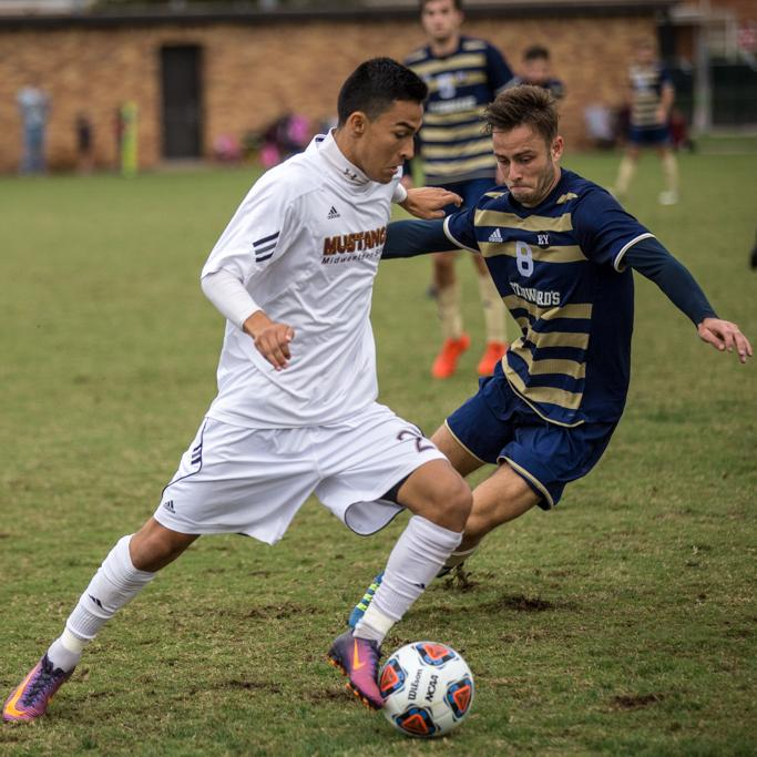 Sebastian Veneges, business management freshman, captures the ball during the heartland conference championship game on Nov 6. Photo by Izziel Latour