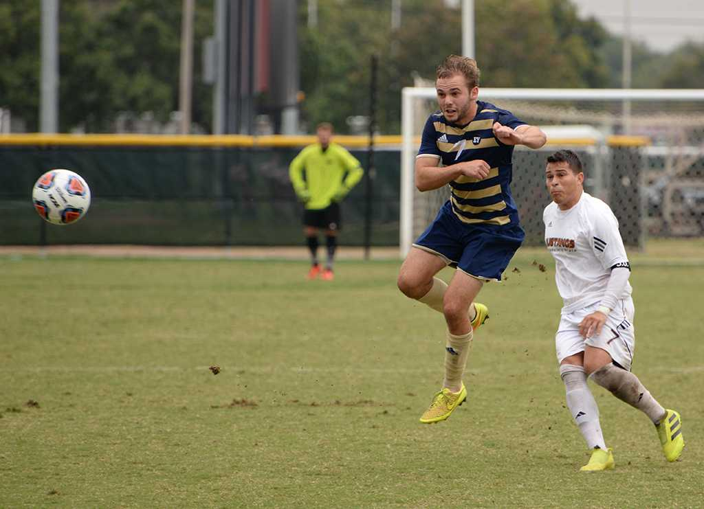 Antonio Hernandez fights for the ball at the Heartland Conference playoff game against St. Edward's. MSU lost 0-2. Photo by Zack Santagate