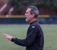 Head soccer coach Doug Elder tries to calm down his team on Nov. 6. Photo by Izziel Latour