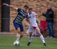 Alex Mullet, finance sophmore, fights for the ball during the heartland conference championship game on Nov. 6. Photo by Izziel Latour