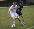 Kyle Bacus, business management senior, figts for the ball during the heartland conference championship game on Nov. 6. Photo by Izziel Latour