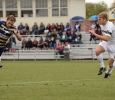 Alex Mullet and Patrick Fitzgerald run for the ball at the Heartland Conference playoff game against St. Edward's. MSU lost 0-2. Photo by Zack Santagate