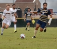 Alex Mullet runs for the ball at the Heartland Conference playoff game against St. Edward's. MSU lost 0-2. Photo by Zack Santagate
