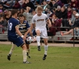 Alex Mullet challenges for the ball at the Heartland Conference playoff game against St. Edward's. MSU lost 0-2. Photo by Zack Santagate