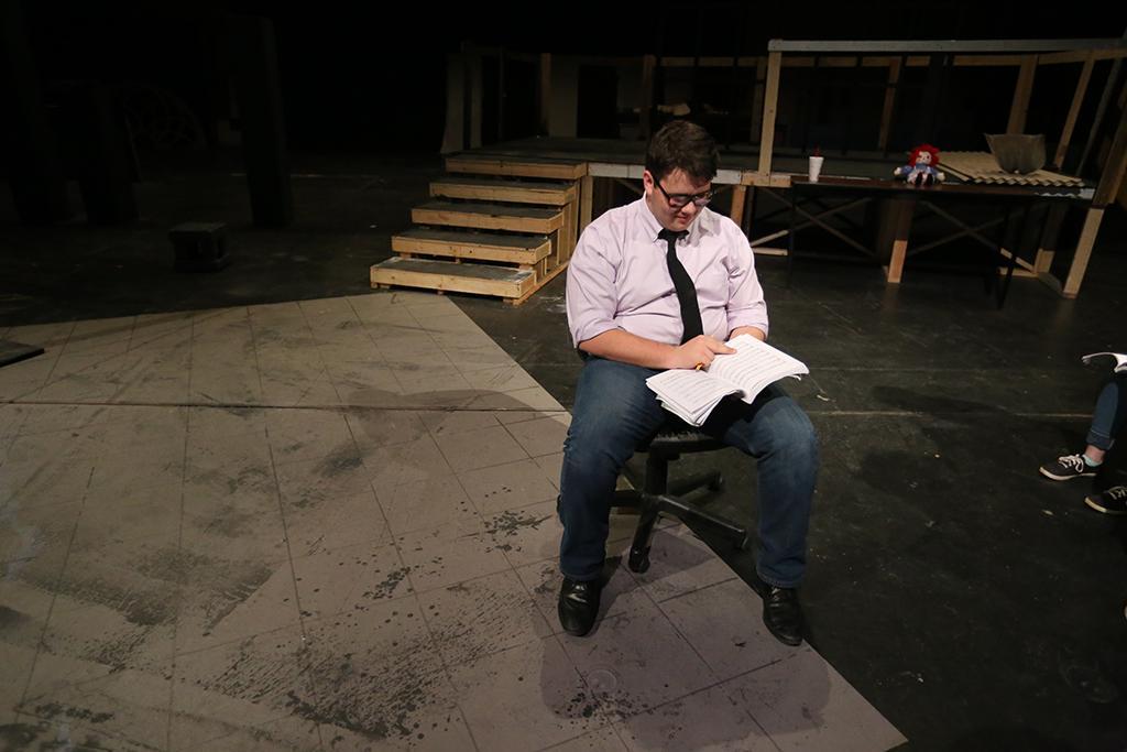 "Steven Kintner reviews lines before ""Urinetown"" rehearsal Jan. 30. Photo by Bradley Wilson"