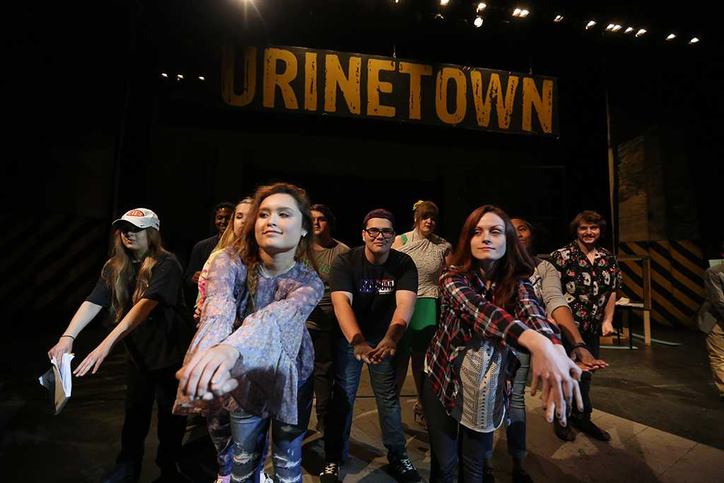 """Steven Kintner and other cast members practice dance moves at """"Urinetown"""" rehearsal Jan. 31. Photo by Bradley Wilson"""