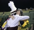 Sabina Marroquin, history education senior, hugs her bandmates as they congratualte her on being Midwestern State University's 2014 Homecoming Queen, Saturday at Memorial Stadium. Elijah Mire, senior, won 2014 Homecoming King. Photo by Rachel Johnson