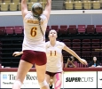 Sarah Rosinke, pre-medicine sophomore, sets the ball up for Sarah Garfield, education and business sophomore to spike to the other side at the D.L Ligon Coliseum on Saturday afternoon against Texas Women's University. Photo by Rachel Johsnon