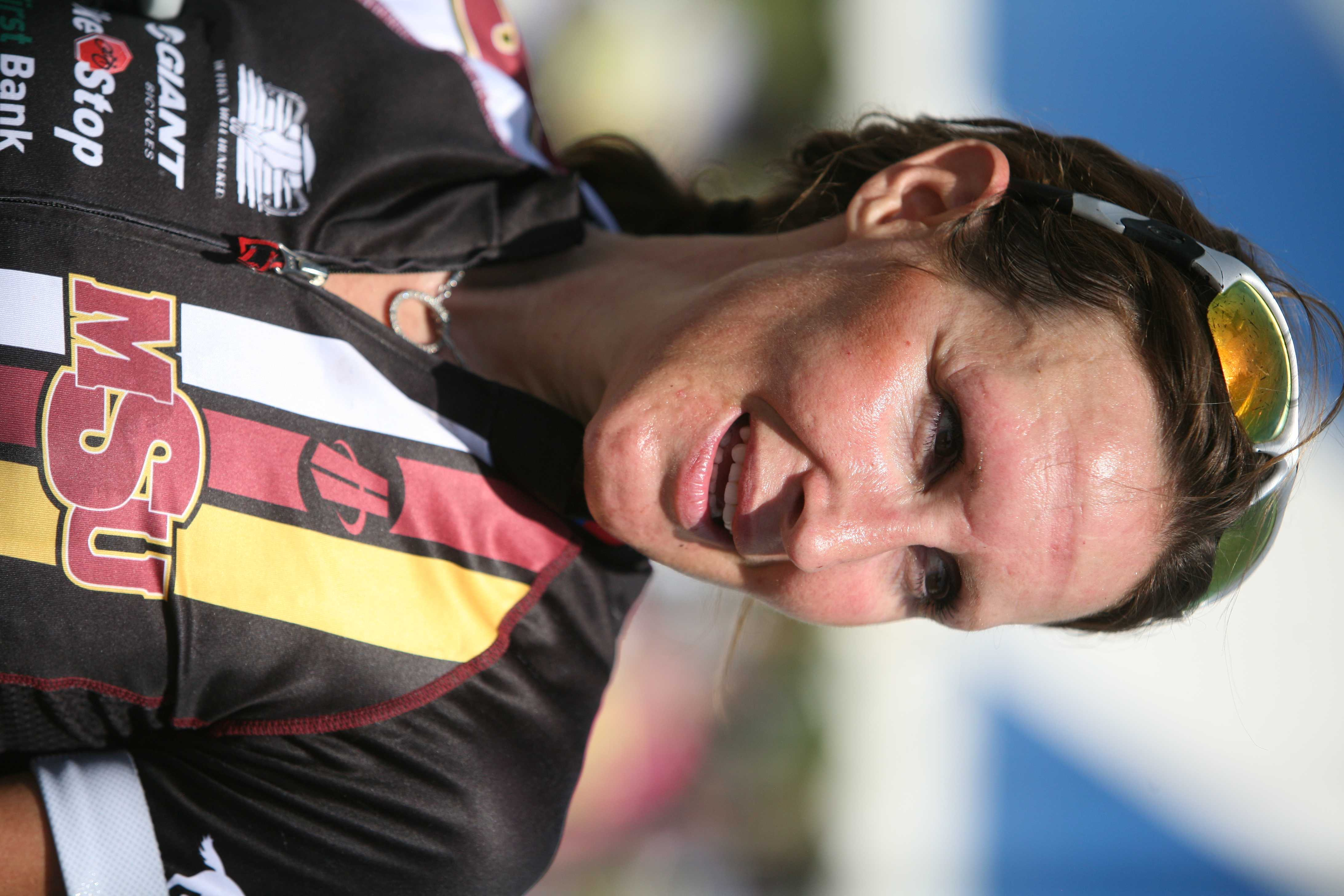 Angela Streadwick, a senior in psychology, after finishing the Hotter'N Hell 100K. Photo by Bradley Wilson