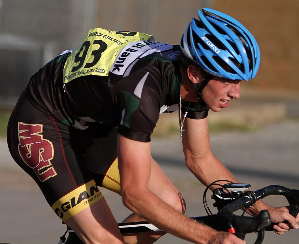 Luke Allen, freshman in political science, rides in the Hotter 'N Hell men's crit races Friday afternoon.