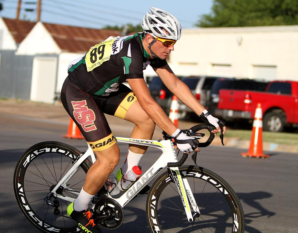 Sean Brown, graduate in exercise physiology, rides in the Hotter 'N Hell men's crit races Friday afternoon.
