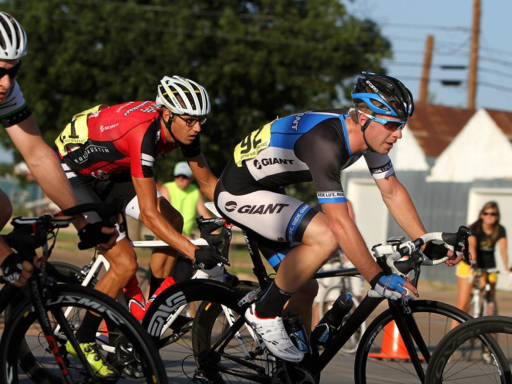 Sam Croft, sophomore in geology, rides in the Hotter 'N Hell men's crit races Friday afternoon.