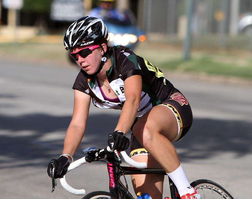 Ashley Weaver, senior in exercise physiology, rides in the Hotter 'N Hell women's crit races Friday afternoon.