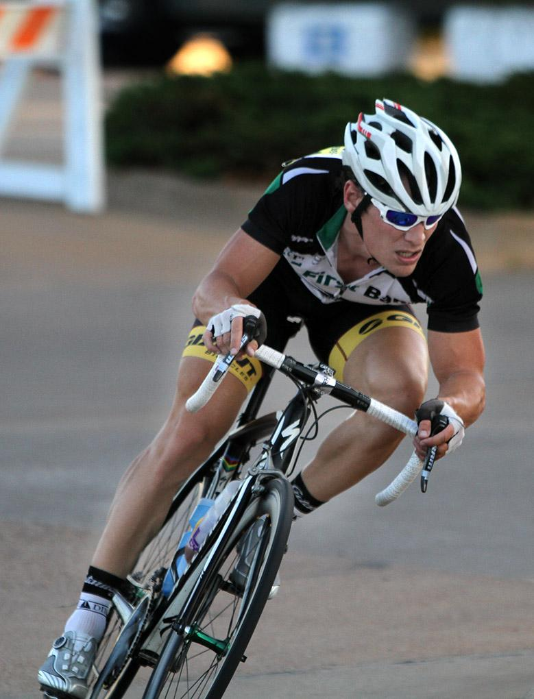 Cory Scott, graduate student in exercise physiology, rides in the Hotter 'N Hell men's crit races Friday afternoon.