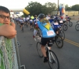 "Marco Torres, psychology senior, watches the endless stream of racers leave the starting gates as he waits to deflate and transfer ""Pyro Pete"" to the Hell's Gate rest stop in Burkburnett. Photo by Ethan Metcalf"