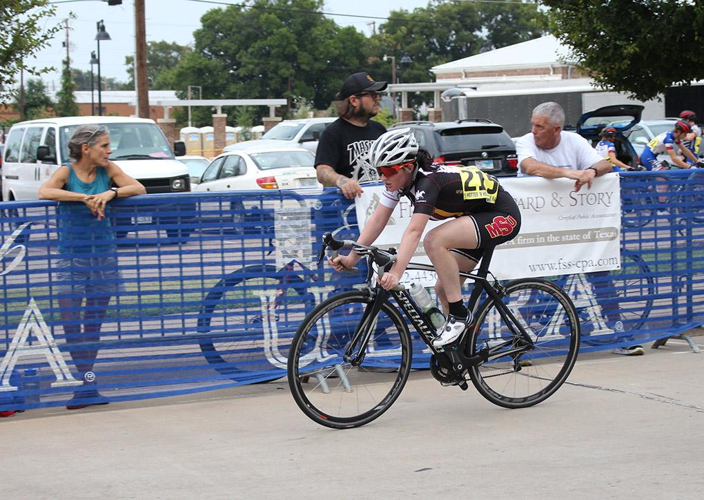 Maxyna Cottam, freshmen, rounds a corner in a race on friday during Hotter n' Hell. Photo by Kayla White.