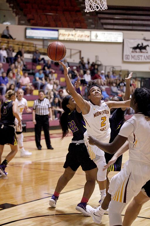 Jasmine Richardson, exercise physiology senior, pushes between two opponets and attempts a shot during the MSU vs Hardin-Simmons game in D.L. Ligon Coliseum where MSU won 61-42, Thursday, Nov. 2, 2017. Photo by Francisco Martinez