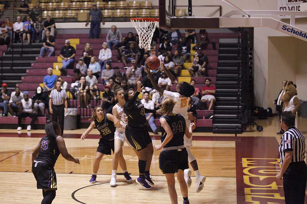 Micheline Mercelita, kinesiology senior, jumps up for a lay-up during the MSU vs Hardin-Simmons game in D.L. Ligon Coliseum where MSU won 61-42, Thursday, Nov. 2, 2017. Photo by Francisco Martinez