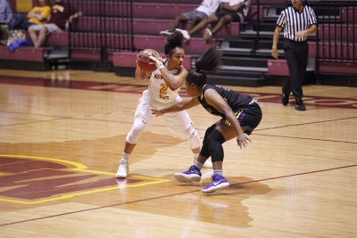 Jasmine Richardson, exercise physiology senior, moves the ball away from opponets reach during the MSU vs Hardin-Simmons game in D.L. Ligon Coliseum where MSU won 61-42, Thursday, Nov. 2, 2017. Photo by Francisco Martinez
