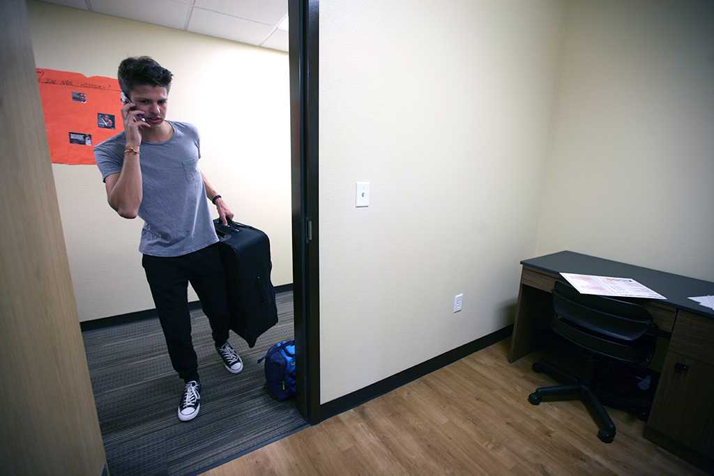 Jordan Smith, criminal justice freshman, goes in to his room for the first time during Move-in for Legacy Hall at Midwestern State University, Aug. 20, 2016. Photo by Bradley Wilson