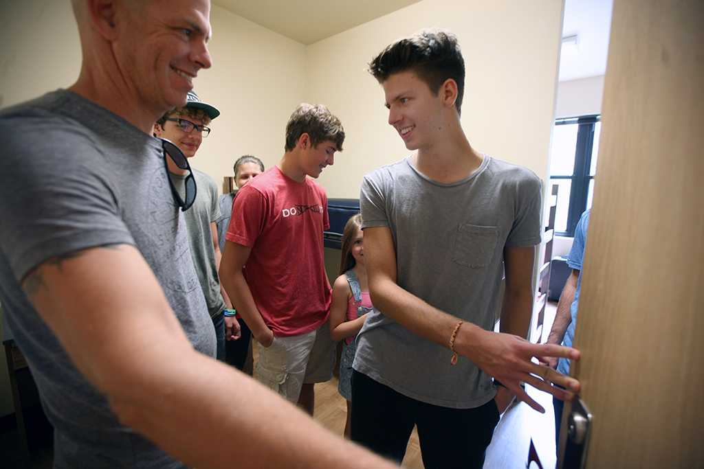 Jordan Smith, criminal justice freshman, had his entire family in his room for the first time during Move-in for Legacy Hall at Midwestern State University, Aug. 20, 2016. Photo by Bradley Wilson