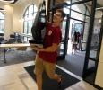 Tanner Conley, business sophomore, moves a television for a resident during Move-in for Legacy Hall at Midwestern State University, Aug. 20, 2016. Photo by Bradley Wilson