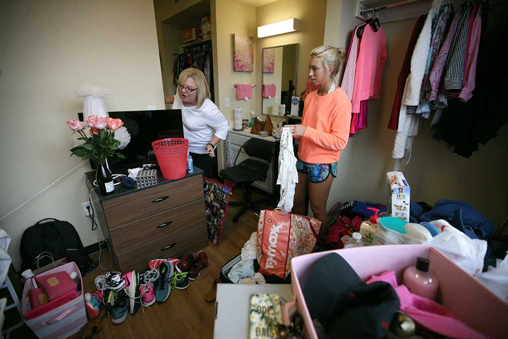 With her mother, Stephanie Moore, Ellie Gunderson, a sophomore in political science, in her new room during Move-in for Legacy Hall at Midwestern State University, Aug. 20, 2016. Photo by Bradley Wilson