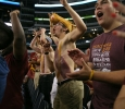 Brandon Allen, mechanical engineering sophomore, cheers with members of the stang gang at Midwestern State University v. Eastern New Mexico game at AT&T Cowboys Stadium in Arlington, Sept. 20, 2014. Photo by Rachel Johnson