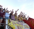 The Mustang Maniacs hold up the 'stang' sign while yelling as Midwestern State's kicker, Andy Alkhazshvilly, business management senior, starts off the first game of the season, Sat. Sept. 5. MSU beat Truman State 31-3 at Memorial Stadium. Photo by Rachel Johnson