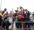 The Mustan Maniacs go wild for the camera to be on TV in the 2015 Maroon and Gold Spring game, Saturday April 18, 2015, which ended early due to a lightening sighting. The first 1,000 fans to attend were given free tshirts, the Kiowa Cooks gave out free hot dogs, along with other bounce houses and free activites for kids. The Maroon team beat the Gold team 7-3. Photo by Rachel Johnson